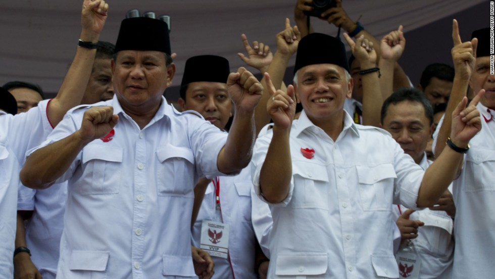 Presidential candidate Prabowo Subianto, at left, and running mate Hatta Rajasa wave to supporters during a campaign rally on June 22. Prabowo was a special forces commander under the regime of his former father-in-law Suharto.