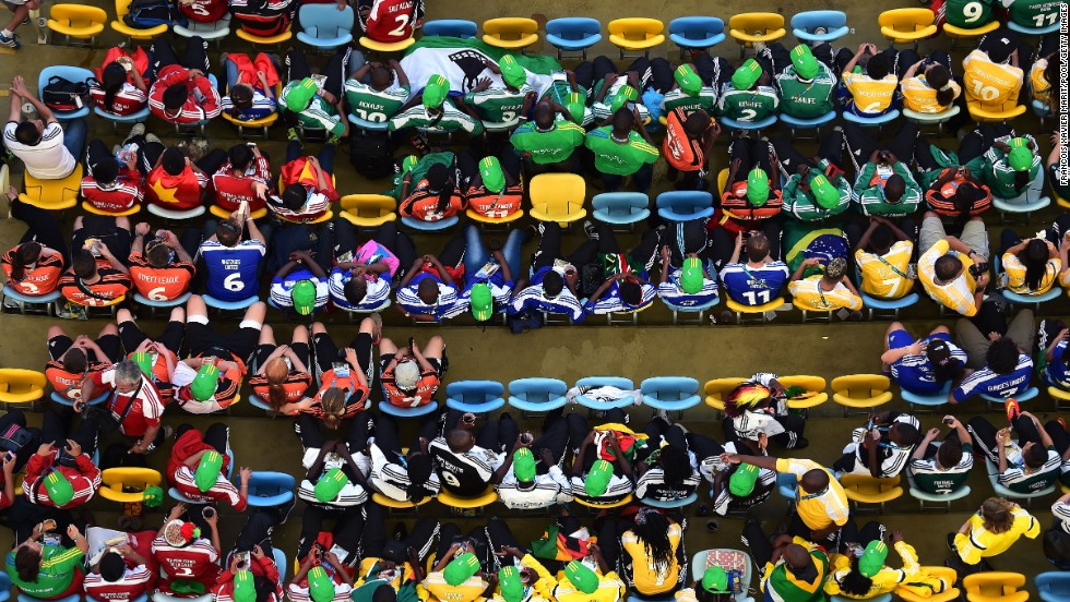 Fans sit in the Maracana stadium before the match.