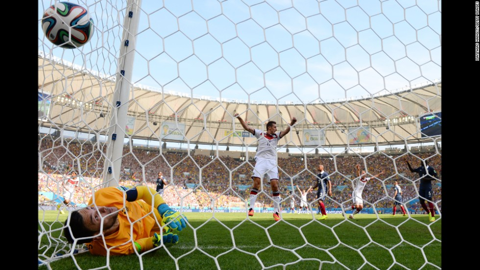 Klose celebrates Hummels' goal as it passes Lloris.