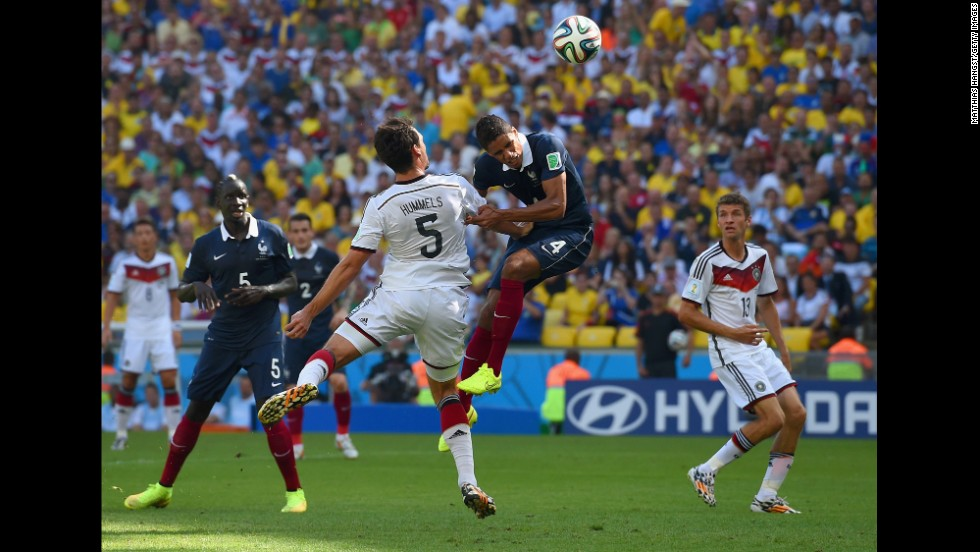 Hummels fights off French defender Raphael Varane to score on his header.