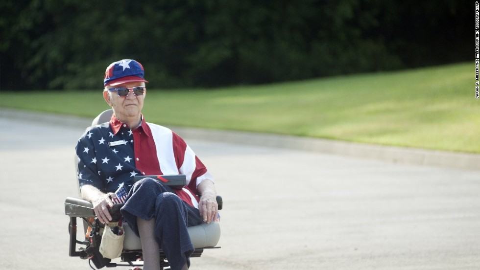 "Walter Lindsay plays Whitney Houston's rendition of ""The Star-Spangled Banner"" during the golf cart parade in Tyler."