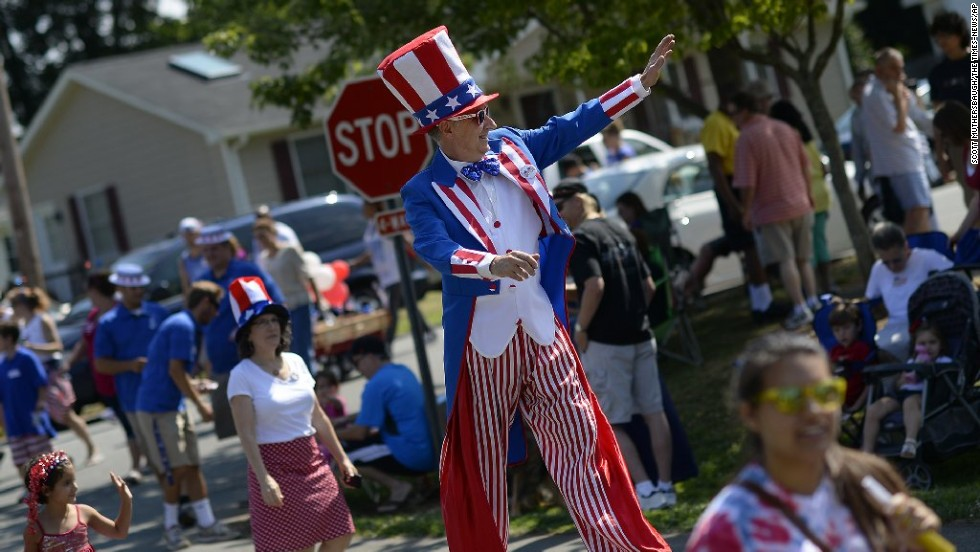 Dave Hodgens walks on stilts during a parade in Mebane, North Carolina.