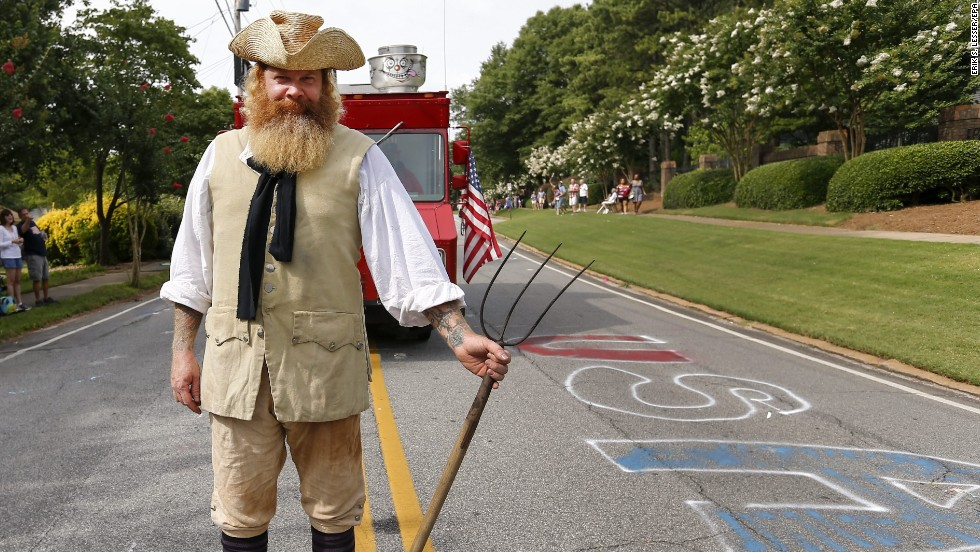 Jim Stacey participates in an Independence Day parade in Avondale Estates, Georgia.