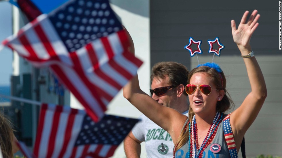Sara Moore cheers during the South Walton Fourth of July Parade in Seaside, Florida.
