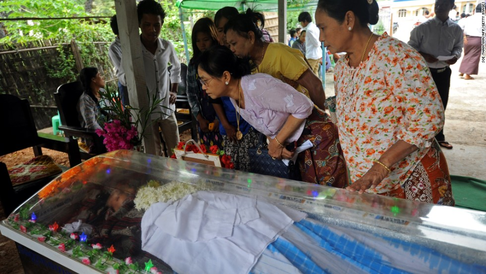 Mourners at the funeral of a victim of the unrest. The violence started at a tea shop owned by a Muslim accused of raping a Buddhist woman, and involved mobs of hundreds of people, some of them armed.