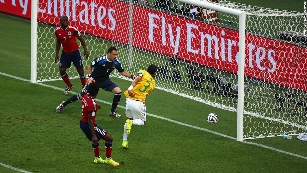 Brazil's captain, Thiago Silva, redirects a corner kick into the net to give his team a 1-0 lead over Colombia early in the first half.
