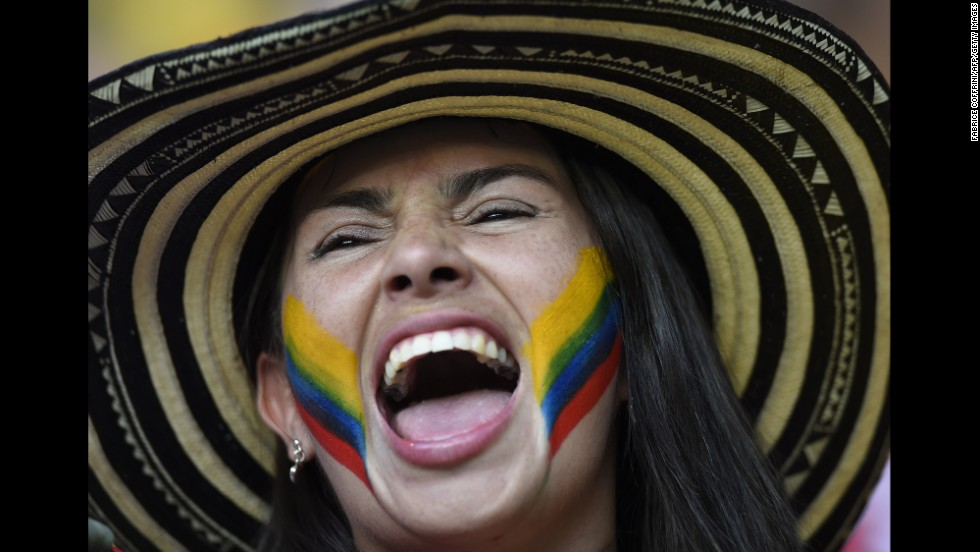 A Colombia supporter cheers prior to the game.