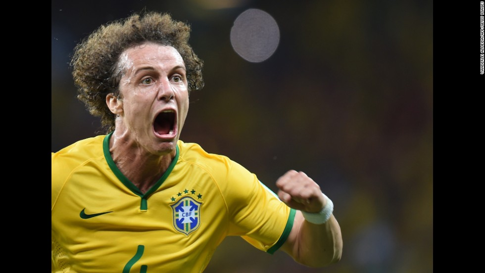Brazilian defender David Luiz celebrates after he scored on a long-range free kick to give his team a 2-0 lead over Colombia.