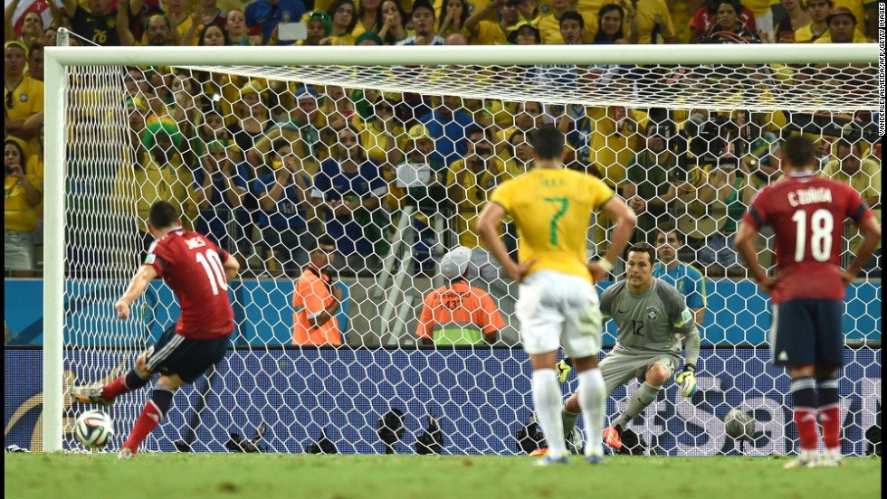 Colombia midfielder James Rodriguez, left, shoots and scores a penalty.