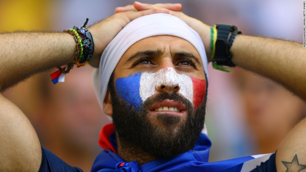 A France fan at the stadium in Rio de Janeiro reacts after the match against Germany.