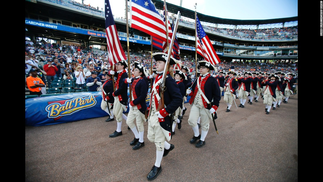 A fife and drum corps entertains the fans before a Detroit Tigers baseball game.