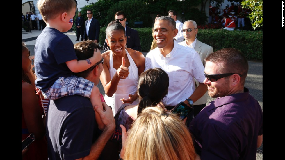 President Barack Obama and first lady Michelle Obama greet military families as they host an Independence Day celebration on the South Lawn at the White House.