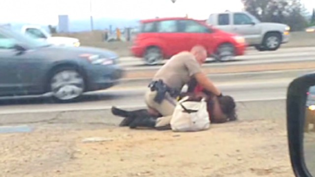Cop caught on camera punching woman