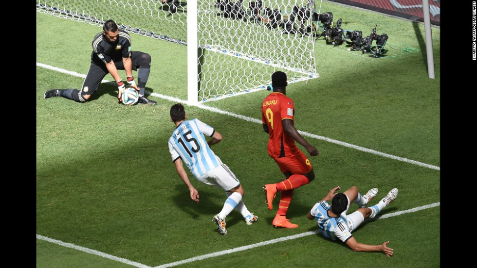 Argentina goalkeeper Sergio Romero, left, makes a save.