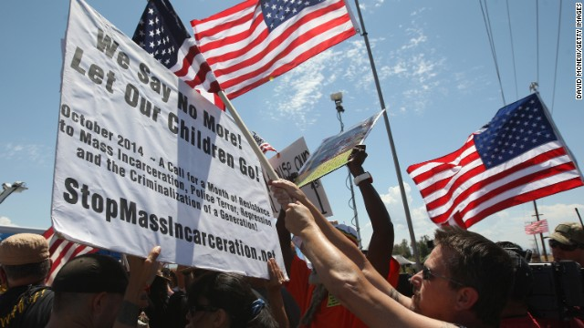 Protesters on Friday await the arrival of migrants in Murrieta, California.