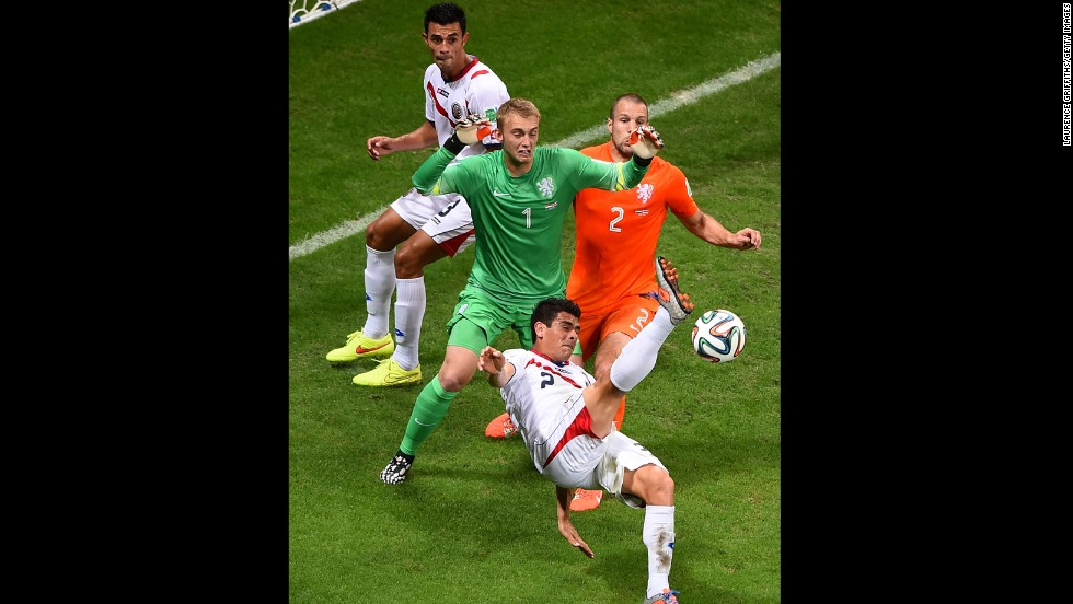 Johnny Acosta of Costa Rica attempts a shot on goal against goalkeeper Jasper Cillessen and Ron Vlaar of the Netherlands.