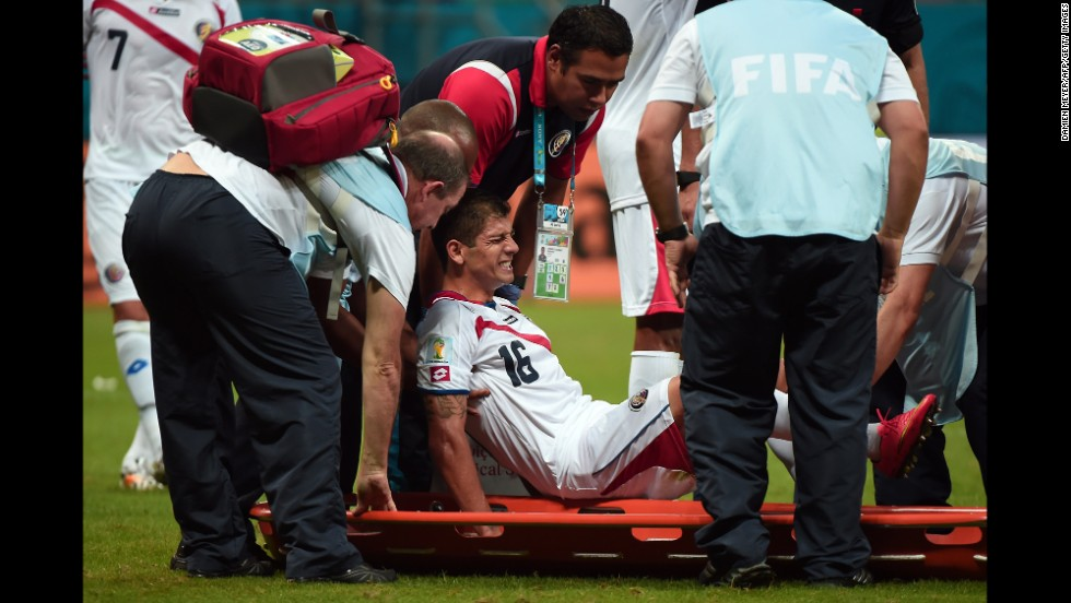 Costa Rica defender Cristian Gamboa  is taken out on a stretcher after an injury.