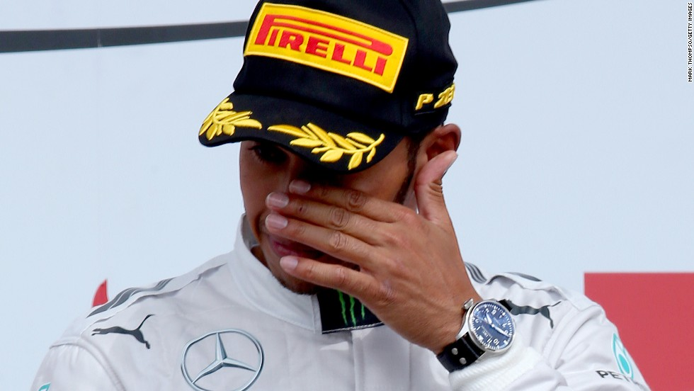 Lewis Hamilton wipes away a tear after his emotional victory at the British Grand Prix at Silverstone.