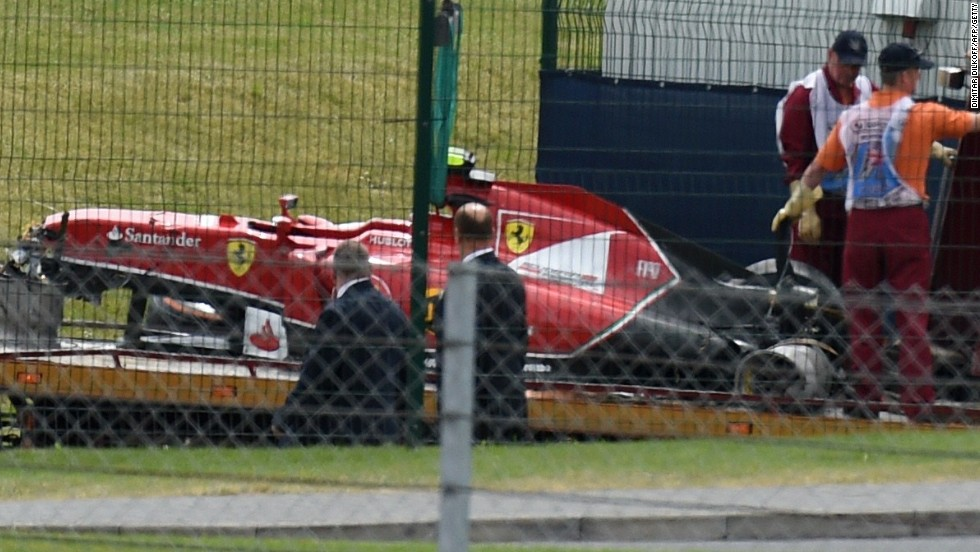 Every picture tells a story. Kimi Raikkonen's Ferrari is towed away after his high speed first lap crash ended his hopes.