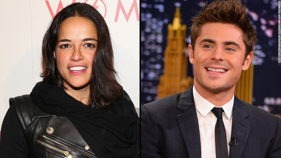 "Actors Michelle Rodriguez -- who was previously linked to model Cara Delevingne -- and Zac Efron <a href=""http://marquee.blogs.cnn.com/2014/07/07/zac-efron-spotted-kissing-michelle-rodriguez/"" target=""_blank"">stirred relationship rumors when they were spotted kissing on a boat</a> in Italy in July 2014 <a href=""http://www.people.com/article/zac-efron-michelle-rodriguez-split"" target=""_blank"">but reportedly only lasted two months as a couple. </a>"