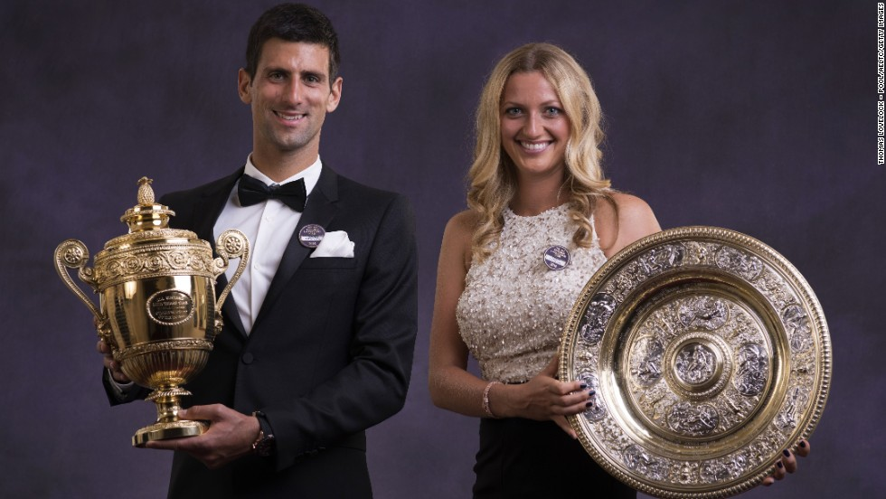 JULY 6 - LONDON, UK: The newly crowned Wimbledon champions, Novak Djokovic of Serbia and Petra Kvitova of the Czech Republic, pose with their trophies at the traditional winners ball -- again. Both players have won their second Wimbledon title, after triumphing at the All England Club in 2011.
