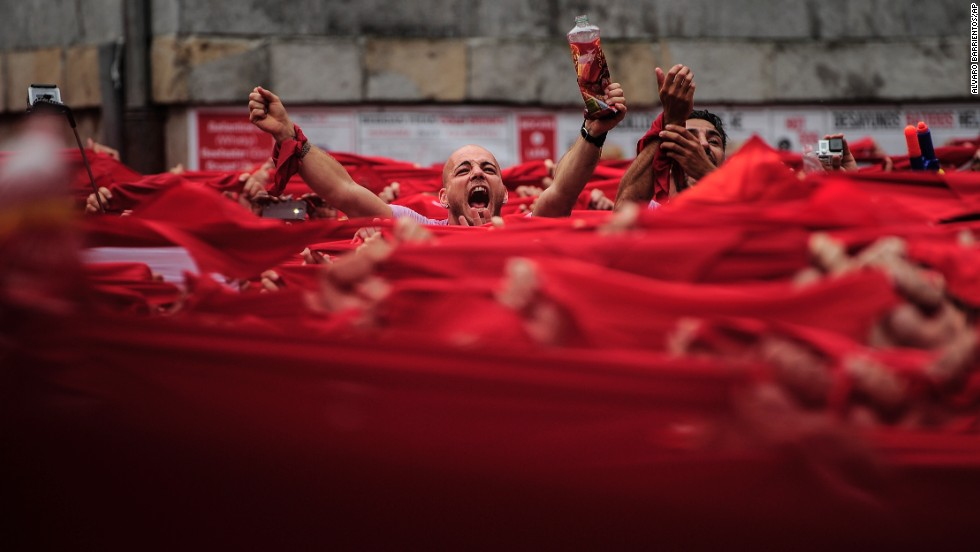 Revelers kick off the San Fermin festival with a messy party in Pamplona's town square on July 6.
