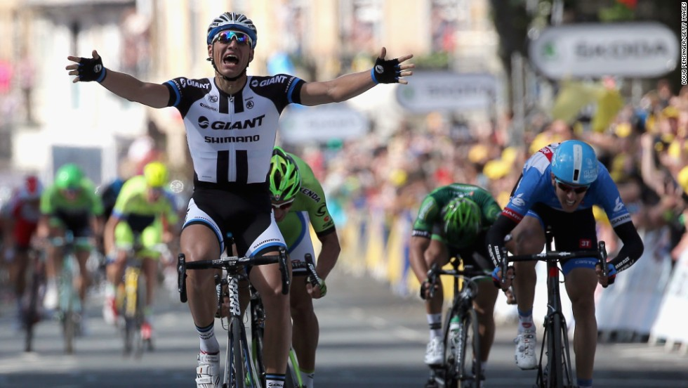 Marcel Kittel of the Giant-Shimano team celebrates his victory in the first stage of the tour.