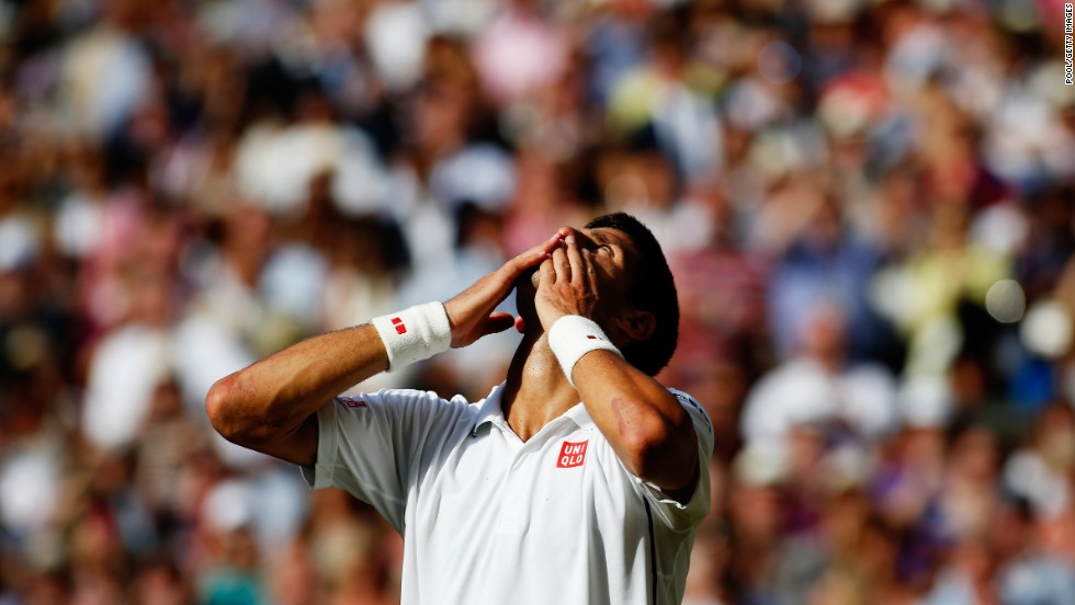 Novak Djokovic blows kisses to the fans as he celebrates his win over Roger Federer in the Wimbledon final Sunday, July 6, in London. Djokovic has now won seven Grand Slam titles, including two at Wimbledon.
