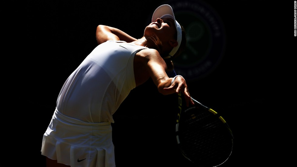 Eugenie Bouchard serves to Angelique Kerber on Wednesday, July 2, during a quarterfinal match at Wimbledon. Bouchard eventually advanced to the final, which she lost to Petra Kvitova.