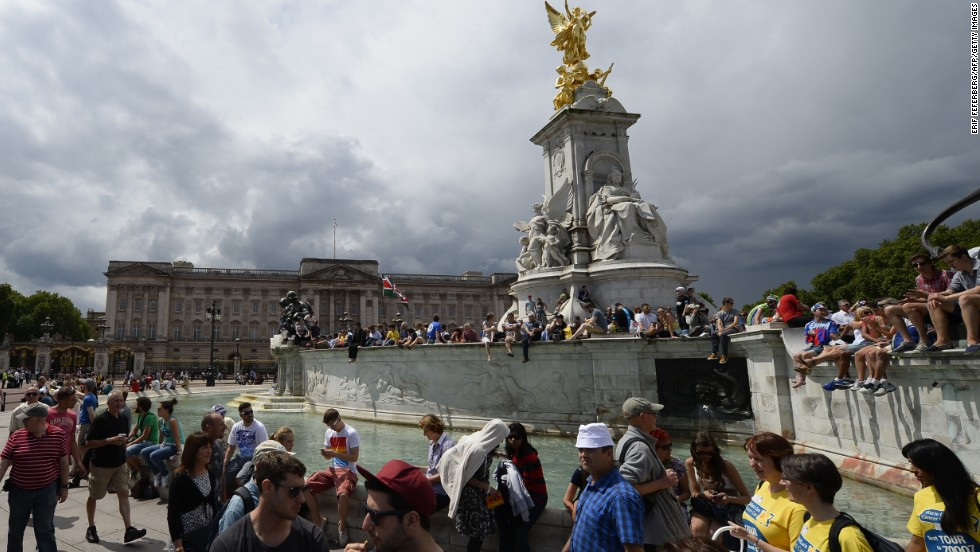 Fans line the streets of London as they prepare to welcome the cyclists on the third stage of the Tour.
