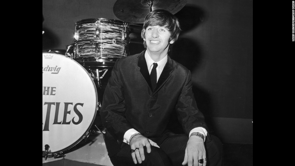 "Suit and tie was a staple in the early days for British drummer Ringo Starr, pictured here on his 24th birthday in 1964.The look was typical of the British ""Mod"" subculture, though when asked in 'A Hard Day's Night' if he was a ""mod or a rocker,"" Ringo replied, ""I'm a mocker."""