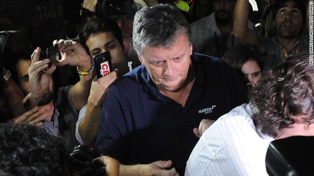 Raymond Whelan arrives at a police station in Brazil after being arrested as part of a probe into illegal World Cup ticket sales.