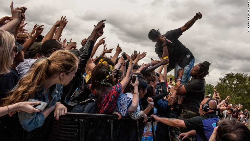 Hip-hop artist B.o.B. takes a selfie with fans at the Wireless Festival in Birmingham, England, on Friday, July 4.