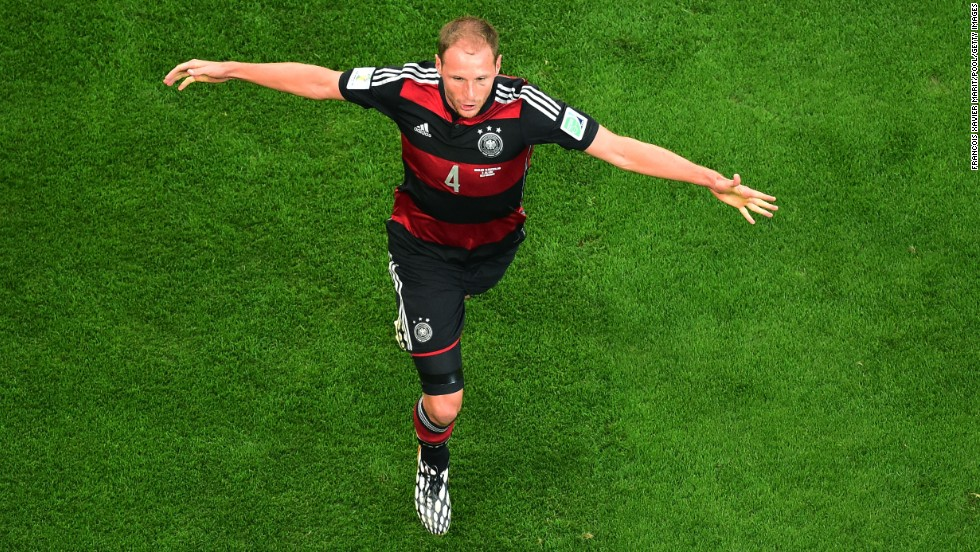 Benedikt Hoewedes of Germany celebrates after teammate Thomas Mueller, not pictured, scored the opening goal against Brazil.