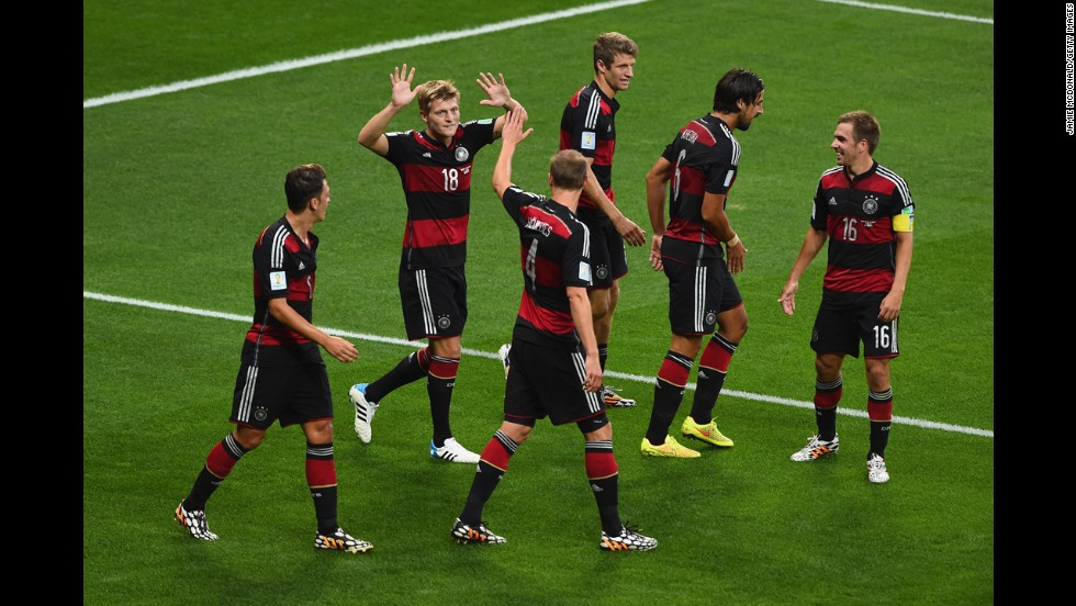 Germany's Toni Kroos, second from left, celebrates scoring his second goal of the game. It put his team up 4-0.