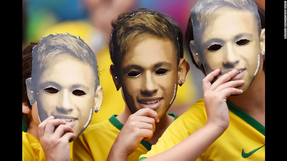 "Fans wear masks of Neymar's face prior to the match. <a href=""http://www.cnn.com/2014/07/05/football/gallery/wc-best-0705/index.html"">See the best World Cup photos from July 5</a>"