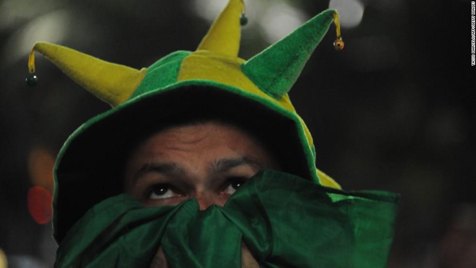 A Brazil fan watches the match in Rio de Janeiro.