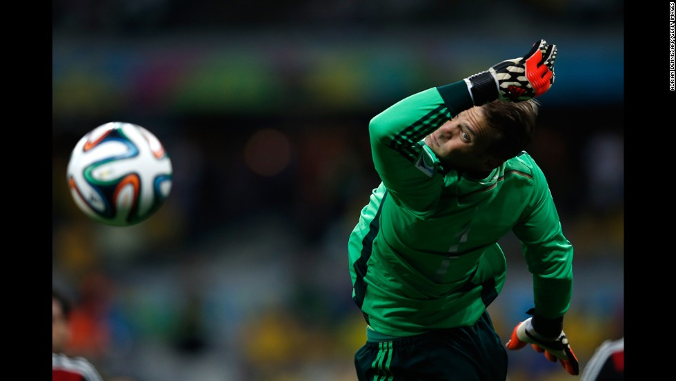 German goalkeeper Manuel Neuer dives for the ball.