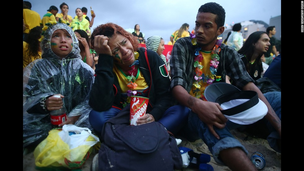 Brazil fans are devastated while watching the first half on Copacabana beach in Rio de Janeiro.