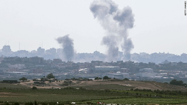 Smoke from an Israeli air strike rises over the Gaza Strip on July 8, 2014.