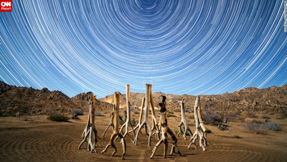 """<a href=""""http://ireport.cnn.com/docs/DOC-1068716"""" target=""""_blank"""">Jason Hullinger</a> went to Joshua Tree National Park last December to catch the Geminid meteor shower. He set up his tripod to take 20-second exposures from about 11 p.m. Thursday to 3 a.m. Friday. He took about 500 photos and combined them with StarStaX, an image stacking and blending software for star trail photography."""