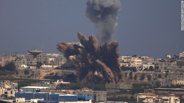A plume of smoke rises over Gaza following an Israel Air Force bombing, as seen from near Sderot, Israel, on July 9, 2014.