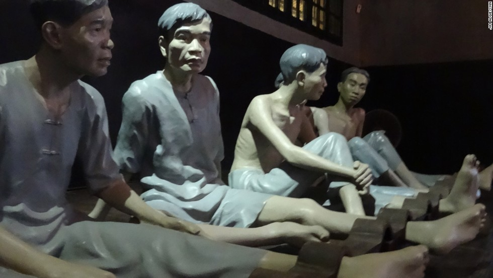 "At Hoa Lo Prison, aka the ""Hanoi Hilton,"" dim lighting and effigies of shackled inmates combine with grainy footage of aerial combat and a French guillotine used to behead Vietnamese prisoners in an attempt to create a level of psychological immersion that feels like incarceration."