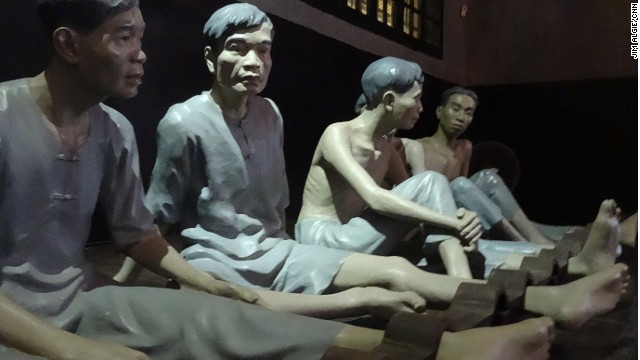 Effigies of shackled inmates at At Hoa Lo Prison.