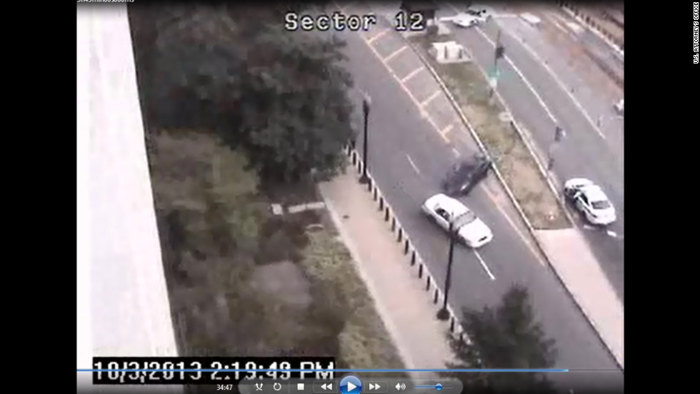 """This still shows the scene as Carey hit a cruiser with her car.  <a href=""""http://www.cnn.com/2013/10/03/us/gallery/capitol-hill-shooting/index.html"""" target=""""_blank"""">See CNN.com's coverage from October. </a>"""