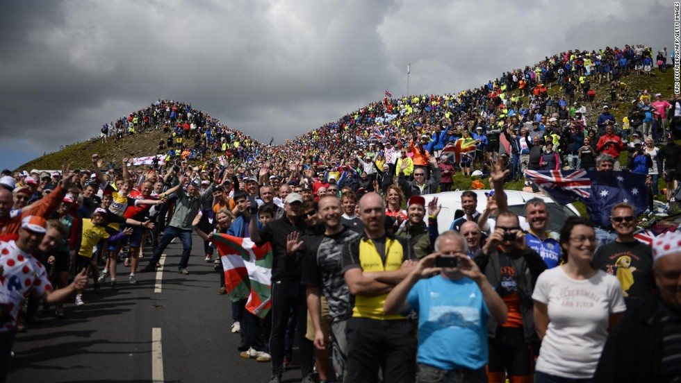 Cycling spectators are seen along a road in England during the first stage of the Tour de France on Saturday, July 5. The legendary road race began in Leeds, England, and will end in Paris on July 27.