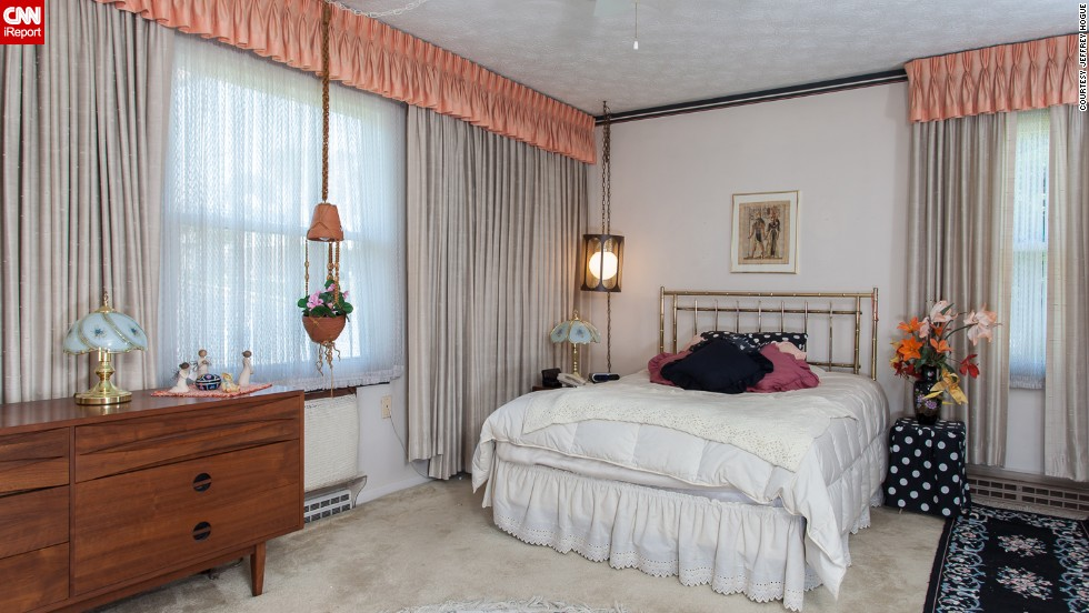 The bedroom, with its low-hanging light, has a charm that takes you back to an earlier era.