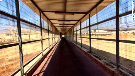 "EREZ CROSSING, ISRAEL-GAZA BORDER:  ""Covered walkway leading into Gaza at the Erez border crossing earlier this afternoon. I took this shot looking back toward the Israel border as I was shuttled down the other direction to the Hamas checkpoint on the back of a motorbike/luggage porter."" - CNN's Jon Jensen, July 10.  Follow Jon (@jonjensencnn) and other CNNers along on Instagram at instagram.com/cnn."