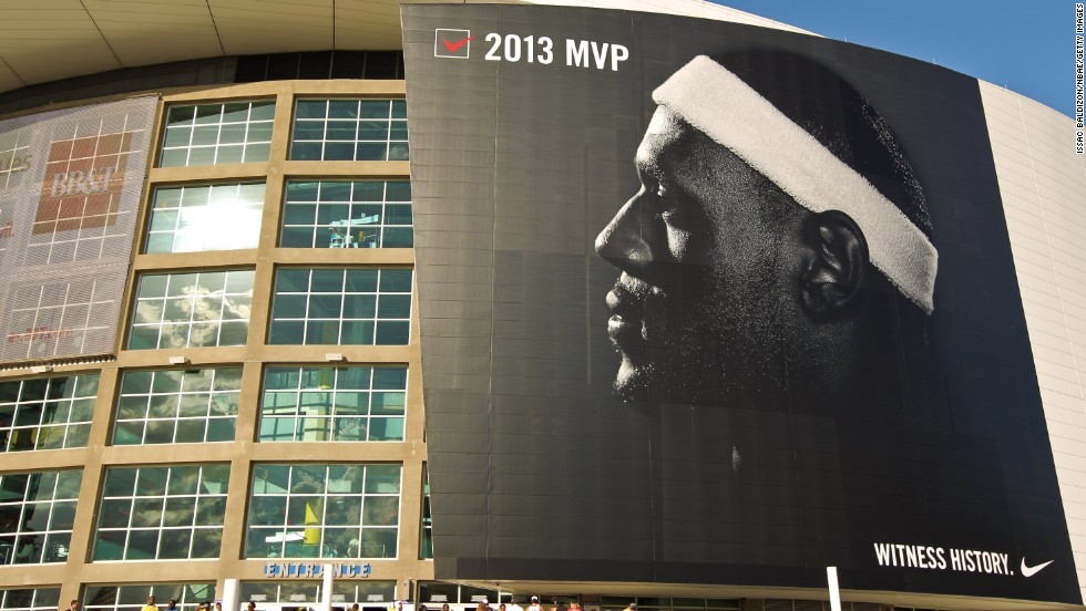 James appears on a Nike poster outside American Airlines Arena in Miami in May 2013. In 2014, James was named the World's Most Powerful Athlete. He has endorsement deals with Nike, Coca-Cola, McDonald's, Upper Deck, Samsung, Audemars Piguet and Dunkin' Donuts.