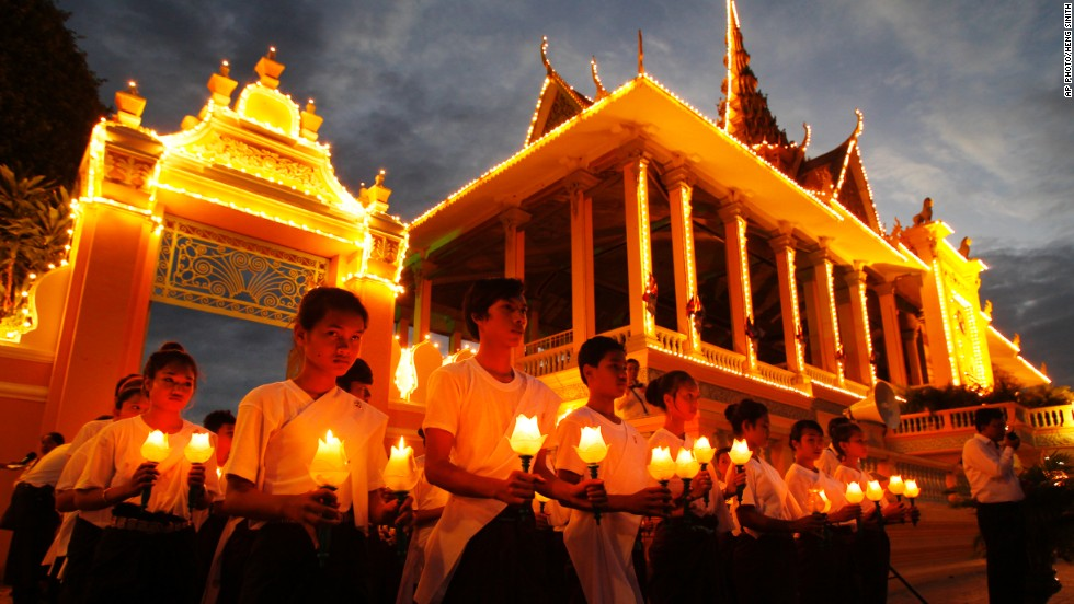 JULY 11 - PHNOM PENH, CAMBODIA: Dancers perform with candles during the three-day Buddhist ceremony for the late King Norodom Sihanouk in front of the Royal Palace on July 10. The remains of the former monarch will be interred during a ceremony at the Palace until July 12.